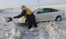 JOE.BRYKSA@FREEPRESS.MB.CA Local- ( standup photo) - Randy Darbell of CAA digs out a car that slid into the ditch on Hyw 101 South near St Annes Road Monday morning-Black ice and high winds caused dangerous driving conditions for motorists sending many slidding into the ditch- JOE BRYKSA/WINNIPEG FREE PRESS- Dec 27, 2010