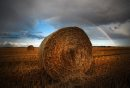 Hay bales sit under a rainbow just west of Winnipeg Saturday, September 3, 2011.(John Woods/Winnipeg Free Press)