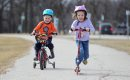 Six year old Petra Steadwell and her little brother Scott-4yrs zoom along on their bike and scooter Saturday afternoon while spending time at  Assiniboine park with her family. March 27 2012 (Ruth Bonneville/Winnipeg Free Press)