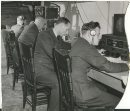 Winnipeg Free Press Archives Winnipeg WWII Home Front November 16. 1943 Left, student signals officers of the R.C.A.F. at work in their home-made radio station in the basement of the Merchants' hotel, Selkirk, Monday afternoon. At the time the picture was taken a twoway conversation was going on between the station and PO. J. Burrell, a returned wireless air gunner, circling over Selkirk in a Norseman plane of No. S Wireless school. Left to right, Pilot Officers H. E. Brownhili, Halifax. N.S.: E. W. Collins, Southseat, England: Stan Stuka, Warsaw, Poland, and H. M. Field, Grande Prairie, Alta. Right, two of the first group of girl signals officers of the R.C.A.F., training at the Tuxedo school, Officer Cadets Neil Ross, Vancouver (left), and Louise Le Clair, North Hustico. P.E.I., operate the VHF (Very High Frequency) transmitter at No. 3 Wireless school. The girls previously qualified- as ground wireless operators at No. 1 Wireless school. Montreal.