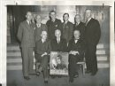 Winnipeg Free Press Archives Winnipeg WWII Home Front January 27, 1941 Life is a whirlwind at provincial war savings committee headquarters, 35G Main Srreet, these days, as zero hour for the big war savings certificates push looms nearer. Pictured above are the chairmen and vice-chairmen of the various main committees who are busily laying plans that will enable 130,000 patriotic Manitobans to save monthly through war savings certificates. Seated on the bench, from left to right, are Peter Lowe, vice-chairman of the provincial committee and chairman of the employer-employee committee; B. J. Tarr. provincial chairman, and G. F. Pearson, chairman of the Manitoba committee. Standing, from left to right, are E. S. Chard, secretary; B. G. Carnegie, a vice-chairman of the Greater Winnipeg enrolment committee; Patrick Gyles, vice-chairman of the Greater Winnipeg co'ramittee; Wilfred Womersley, manager of the enrolment committee and publicity chairman of the Greater Winnipeg committee; Paul DuVal, chairman of the enrolment committee, and Dr. H. B. Sommcrfeld. chief organizer of the Manitoba committee. 'Missing from the picture are C. E. Graham, vice-chairman of. the Manitoba committee; D. R. Ferguson, former chairman of the employer-employee committee; C. F. Gray, director for Manitoba, employer-employee committee; W. T. Gwyn, a vice-chairman of the provincial committee; Cecil Lament, chairman of the publicity committee;,1- Stanley N. Jones, vice-chairman of the enrolment committee, and E. G. Persse, chairman of the Greater Winnipeg committee.