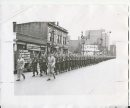 Winnipeg Free Press Archives Winnipeg WWII Home Front September 23, 1940 Soldiers salute the Red Cross Helping the Canadian Red Cross society in its urgent appeal for $5,000,000 to carry on its essential work, some 500 soldiers stationed at the infantry training centre. Fort Osborne barracks, paraded through downtown Winnipeg, Monday. Here a detachment is shown marching along Portage Avenue.