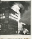 Jack Ablett/Winnipeg Free Press Archives Time Building Fire  (07) June 8, 1954 Flames Race With Lightening Speed To Additional Targets  Fire has caught the Dismorr block, housing Dayton's store, and firemen pour on water in efforts to check the blaze. fparchive