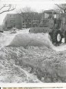 Gerry  Cairns/Winnipeg Free Press Archives Winnipeg Blizzard (4) March 5, 1966 A  grader with a front end loader takes a stab at clearing Balmoral Street. Winter storm, March 4, 1966 fparchive