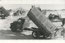Gerry Cairns/Winnipeg Free Press Archives Winnipeg Blizzard (5) March 5, 1966 Dumptrucks - City snow dump - Louise Bridge  fparchive