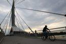 Cyclist rides ...