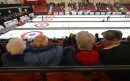 Curling fans ...