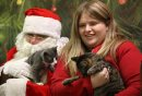 Santa holds ...