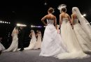 JOE.BRYKSA@FREEPRESS.MB.CA Local-(Standup photo)- Brides Everywhere- On the catwalk at a  fashion show at the Wonderful Wedding Show at the Winnipeg Convention Center Saturday afternoon-The show features over 400 displays and over 90,000 square feet of the latest must-have wedding fashions and trends, wedding products and services- The show continues Sunday- Jan 16, 2010 JOE BRYKSA/WINNIPEG FREE PRESS