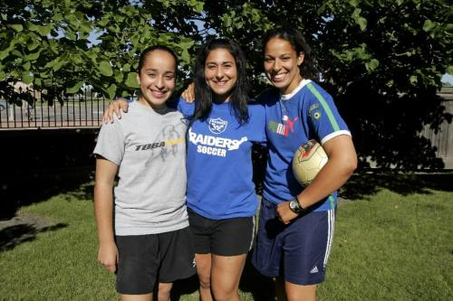 MIKE DEAL / WINNIPEG FREE PRESS  Michelle Martinez (left), coach Elena Scourar (centre) and Raven Sharma (right). Provincial champs the Oak Park Raiders' top athletes Michelle and Raven were both offered scholarships to American universities.