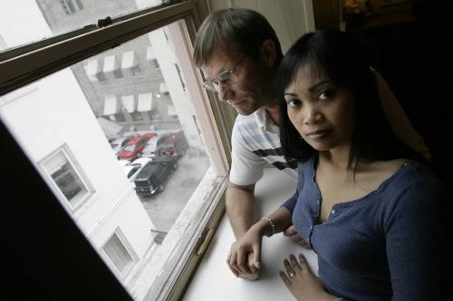 John Woods / Winnipeg Free Press / August 31 2006 - 060831 - Les and Wendy Hiebert look out their downtown Winnipeg hotel room window Thursday, August 31/06.  The Hiebert's who are in Winnipeg to visit family were recently accosted by two panhandlers on Portage Avenue.  When Les attempted to contact police after the incident he was unable to get through to an officer.