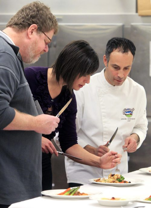 MIKE.DEAL@FREEPRESS.MB.CA 101210 - Friday, December 10, 2010 - Five student chefs took part in the Red River College Iron Turkey Chef Competition on Friday at the college's Notre Dame campus. Judges (l-r) Free Press humourist Doug Speirs, Krista Pratt from Manitoba Turkey Producers and Jason Wortzman from Granny's Poultry. See Doug Speirs story. MIKE DEAL / WINNIPEG FREE PRESS