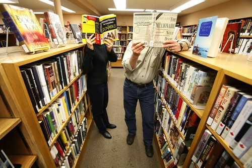December 23, 2010 - 101223  -  Subjects for the Dec. 26 Money Makeover pose for a photograph at a library on Thursday, December 23, 2010. John Woods / Winnipeg Free Press