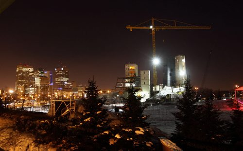 KEN GIGLIOTTI / WINNIPEG FREE PRESS / Dec 28  2010 'Äì  STDUP Weather 'Äì The Canadian Museum for Human Rights continues to rise  , joining the Winnipeg skyline .¬-The Forks Witer Park snow boarding , slide and  Scotia Stage skating rink are  ready  for use.Pic taken just before dawn Tuesday CMHR