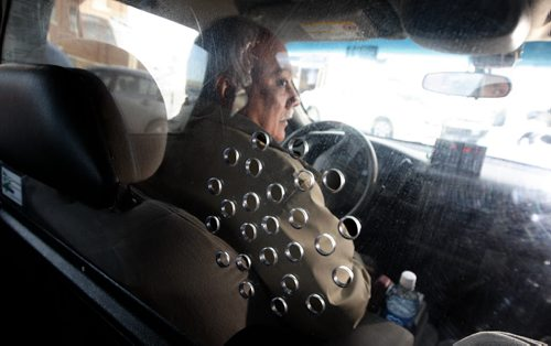 KEN GIGLIOTTI / WINNIPEG FREE PRESS / Dec 30  2010 – Adam Wozny story – new taxi shields to protect drivers – in pic Spring Taxi Driver Othman Zeid has clear plastic shield in his cab