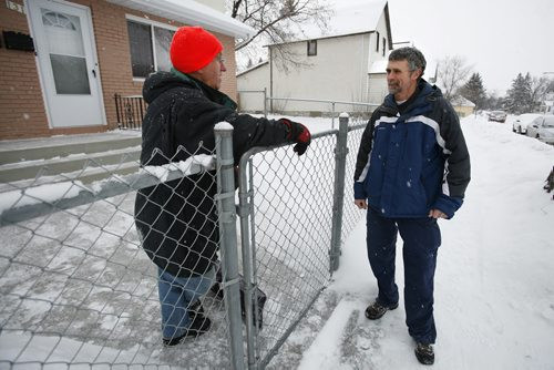 January 13, 2011 - 110113  -  On Thursday, January 13, 2011 Terry Woods meets his new neighbor Americo Martins for the first time on Grove Street, the North End street he is planning to move to once his home is built.  Woods has bought an empty lot in the North End which he plans to build a home on this summer and live in. John Woods / Winnipeg Free Press