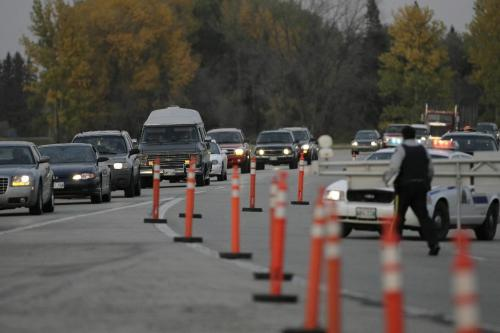 John Woods / Winnipeg Free Press / October 6, 2006 - 061006 - RCMP diverted traffic into Portage after they closed the Trans Canada overpass just east of Portage Friday Oct 6/06.  It is reported the bridge was closed because it is unsafe.