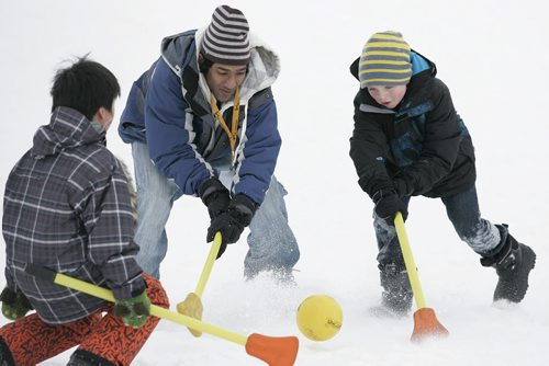 Winnipeg, Manitoba - 110305 -  (Lto R) Vic Wang (10) Roh Guenka and Kade Lowes (10) pplay some ball at the Midwinter's Night Dream festival at Acadia Junior High school in Winnipeg Saturday, March 5, 2011. (John Woods/Winnipeg Free Press)
