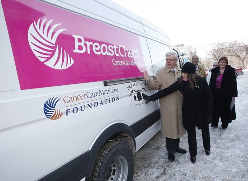 KEN GIGLIOTTI / WINNIPEG  FREE PRESS / MARCH  8 2011 – Bruce Owen story - BREAST SCREENING — The province is announcing the arrival of two new mobile breast screening vans at simultaneous press conferences in Winnipeg and in Gimli. Selinger and Dr. Dhaliwal will be at the Legislative Building, while Oswald and others will be at Johnson Memorial Hospital in Gimli. In pic front  left to right Greg Selinger  with Georgette Jhass  from Pledge the Ride  they raised $67,000 to replace one of the tow aging vans , also in pic rear Dr. Dahli Dhaliwal Pres,& CEO of CancerCare Manitoba and Anita Stenning Executive Director of Manotiba CancerCare Foundation  with one of the two new  breast cancer screening vans