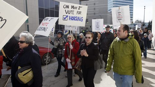 KEN GIGLIOTTI / WINNIPEG FREE PRESS / APRIL 19 2011 - Aldo Santin story-  The Red Tent  Campaign  March for Housing was held  in downtown Wpg  at 10 am organized  by a coalition of housing advocacy organizations  that include Right to Housing Coalition in MB , the group wants more affordable and social housing. they started their walk at the  Norquay Bldg