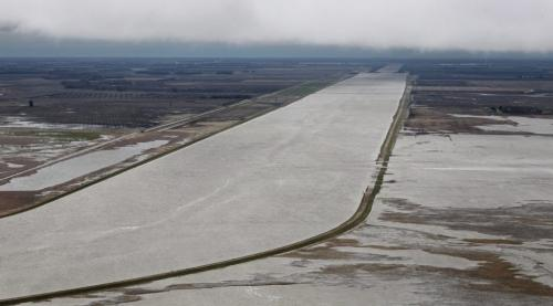 MIKE.DEAL@FREEPRESS.MB.CA 110512 - Thursday, May 12, 2011 -  Flood Flight Water from the Portage Diversion overflows its banks spilling into fields west of the diversion close to Lake Manitoba. MIKE DEAL / WINNIPEG FREE PRESS