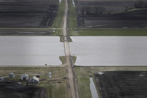MIKE.DEAL@FREEPRESS.MB.CA 110512 - Thursday, May 12, 2011 -  Flood Flight Water from the Portage Diversion just flows under the HWY 227 bridge. MIKE DEAL / WINNIPEG FREE PRESS