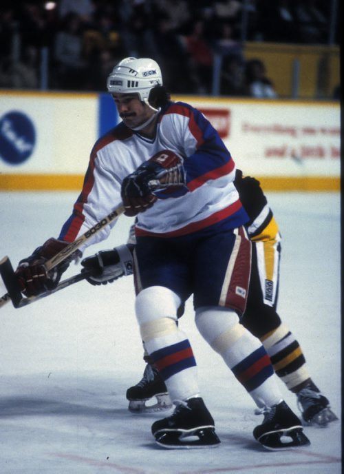 Winnipeg Free Press / KEN GIGLIOTTI / OCT 1 1982 - JETS  Jimmy Mann in action vs  Pittsburg  Photo Book Project - Wpg Winnipeg Jets Hockey Club - NHL National Hockey League return -  ( kgjets brings up all Wpg Jets recovered photos in Merlin new book project pics will have slug newjets  for archive pics put in after june 7 2011 )  photos cannot be  published without written permission from the Winnipeg Free Press and credit must include  the Winnipeg Free Press and photographer with each photo