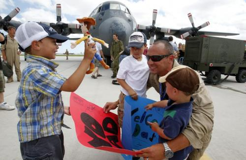 20-25 members of Winnipeg's 435 squadron of Hercules crewmen return from their two-month deployment in Libya. Here Capt. Lucas Shaver is greeted by his boys  (L-R) Ripkin, Maddox, and Lukas. His hometown is Ottawa, Ontario. July 14, 2011 (BORIS MINKEVICH / WINNIPEG FREE PRESS)