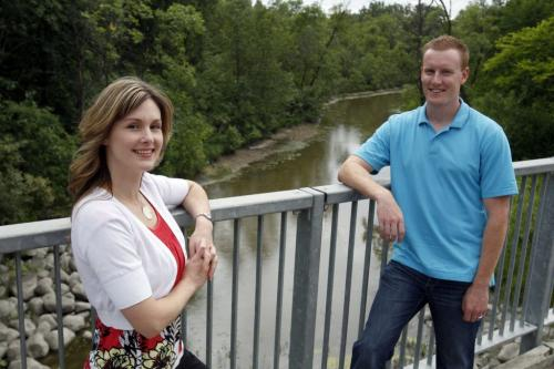 VOLUNTEER COLUMN- Save our Seine river environment inc. -Executive Director Kristine Koster and board member Cameron Regier pose for a photo on a bridge that crosses the Seine River. August 8, 2011 (BORIS MINKEVICH / WINNIPEG FREE PRESS)