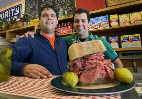 Tyler Steek, left, and his brother Harrison at Myer's Deli on Grant Ave with the Hustler and Lawless sandwich which is packed with 350 grams of meat– See Detour story – Sept 13, 2011-(JOE BRYKSA / WINNIPEG FREE PRESS)