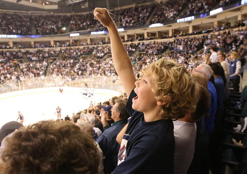 Winnipeg Jets fan Mathew Hedden cheers after a third period goal during play against  Columbus Blue Jackets during  NHL preseason hockey in Winnipeg Tuesday –The city of Winnipeg welcomed the   NHL back to the city after a 15 year drought since 1996 when the team relocated to Phoenix - See Ed Tait's story – Sept 20, 2011   (JOE BRYKSA / WINNIPEG FREE PRESS)