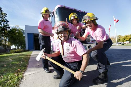 """Fire Fighters from Station 8 at 640 Kimberly Ave. are inviting cancer survivors and their friends and family to come and sign """"Pinky"""" the pink fire engine in support of the fight against all cancers, especially breast cancer all day Saturday at their Station and on Sunday at Station 1 located at 65 Ellen Street.   Names from left - Jay Shaw, Barry Savage, Ian McKenta and Captain Bob Ezinicki (centre with axe). Oct 1, 2011 Ruth Bonneville  Winnipeg Free Press"""