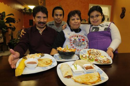 FOOD REVIEW - Cafe Mercadito Latino. Various dishes. L-R The Lemus family. Julian, Jesse, Sonia, and Suzette. November 23, 2011 (BORIS MINKEVICH/ WINNIPEG FREE PRESS)