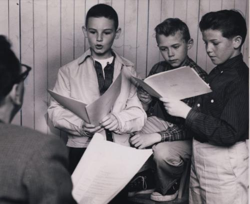 "Winnipeg Free Press Archives June 23, 1958 ""Let me hear how you'd read that line."" John Hirsch, one of the directors of the Rainbow Stage, listens to three young aspirants for roles in The King And I. A notice of tryouts brought out a number of boys to fill the two important roles of the Young Prince and the son of Anna. Reading from left to right, these three aspirants are: Burton Cummings, 10, of 97 Lansdowne Ave; Fred Westman, 12, of 58 Crowson Bay; Jim McCarthy, 12, 263 Donalda Ave."