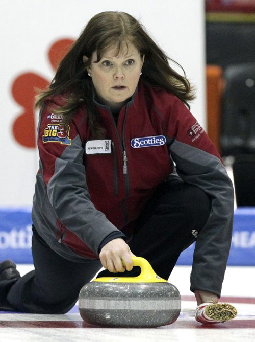 Skip Barb Spencer throws a rock against Team Jennifer Jones in the Friday evening draw of the Scotties Tournament of Hearts in Portage la Prairie at the PCU Centre. 120127 - Friday, January 27, 2012 -  (MIKE DEAL / WINNIPEG FREE PRESS)