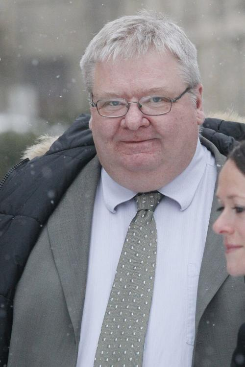 January 30, 2012 - 120130  -   Mark Stobbe, who has been charged with killing his wife Beverly Rowbotham in 2000, leaves court in Winnipeg Monday January 30, 2012. John Woods / Winnipeg Free Press