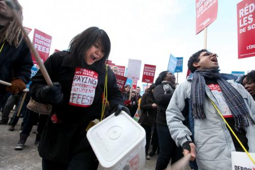 University of Winnipeg student Ronnie Cruz (drumming) drums and chants along with hundreds of post secondary students rally together at the Leg Wednesday afternoon for a freeze on tuition fee's. Feb 01, 2012 (Ruth Bonneville / Photographer) Winnipeg Free Press