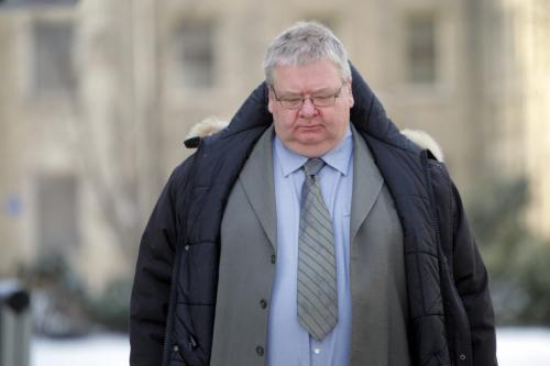 Mark Stobbe, who's accused of beating his wife Beverly to death with a hatchet, out for a break from the trial. Photo taken in front of Law Courts buidling. REPORTER: Bruce Owen.  February 1, 2012 BORIS MINKEVICH / WINNIPEG FREE PRESS