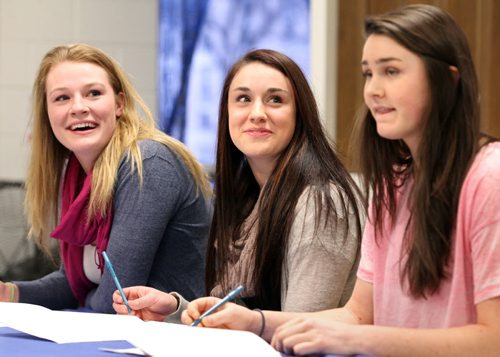 Brandon Sun From left: Jodie Baker, Mary Thomson and Gillian Leech share a laugh while signing their letters of intent for the Brandon University Bobcats womens' volleyball team, Wednesday afternoon. (Colin Corneau/Brandon Sun)