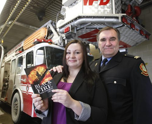 Writer Lindsey Enns holds the book she wrote called Black Fire, A tribute to firefighters beside her father Don Enns. ¤Lindsey has just published a book about the Place Gabrielle Roy fire that killed two Winnipeg firefighter captains on Feb. 7, 2007. The story is about Lindsey writing the book as both a Winnipeg local and the daughter of a firefighter captain, Don, who was supposed to be at that fire.        Hilary Roberts story (WAYNE GLOWACKI/WINNIPEG FREE PRESS) Winnipeg Free Press Jan. Feb 22 2012