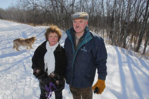 Victoria Macdonald and Al Roberts pose for a photo on the transcanada trail near the corner of Buckingham and Ridgewood in Charleswood. They are part of a group that is not happy with Ridgewood South, a proposed developement in a natural area south of the trail. February 27, 2012  BORIS MINKEVICH / WINNIPEG FREE PRESS