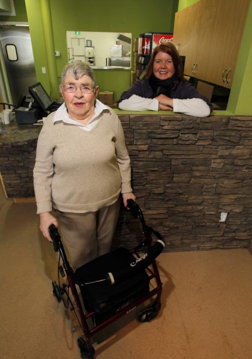 """Volunteer Dorothy, who will try cleaning tables when the Cafe opens up, and """"'Arche Tova Cafe manager Belinda Squance pose for a photo in the almost ready to open cafe in Transcona. River East Transcona School division opened the cafe and offer work to special needs people in the community March 2, 2012  BORIS MINKEVICH / WINNIPEG FREE PRESS"""
