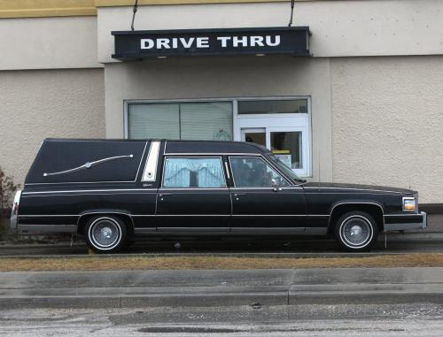 Dying for Lunch-A hearse waits at the Kentucky Fried Chicken outlet drive through at Notre dame and Sherbrook Ave Tuesday- Standup Photo- March 27, 2012   (JOE BRYKSA / WINNIPEG FREE PRESS)