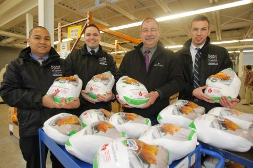Ferdinand Fuentes, Neil Fishman, John Pisker, and Alex Bolotnyy pose with the 30 turkeys their comany Lakeview Hospitality is a division of Lakeview Management Inc., headquartered in Winnipeg, MB. donated to Winnipeg Harvest. The hotel chain has donated 30 turkeys to Winnipeg Harvest to help with its desperate need for food items. Four Points by Sheraton will turn over the high protein birds this morning at the food bank before a cooking demonstration. The donation is in response to the urgent food crisis facing Harvest and comes just in time for the holiday weekend. Despite the large donation, more non-perishable food items are still needed and can be dropped off at any Canada Safeway location or the food bank in-person at 1085 Winnipeg Avenue. (info from the internet) April 3, 2012  BORIS MINKEVICH / WINNIPEG FREE PRESS
