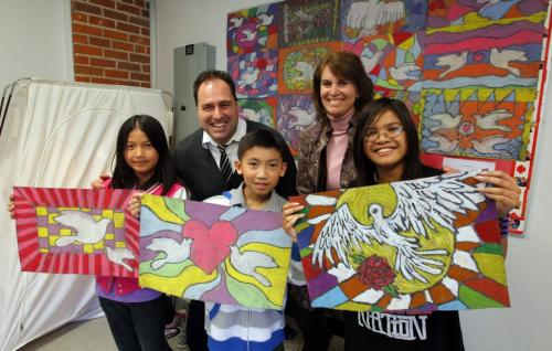 The Starlight Children's Foundation 2nd Annual Art Project allows selected students to create a piece of original artwork to be auctioned off for the charity. Stefi Remonte, 9, Fong Ma, 10, Denice Villanueva, 10, in the front row in front of teachers Antonio De Geronimo and Merrill hunter ar in the back smiling.  April 10, 2012  BORIS MINKEVICH / WINNIPEG FREE PRESS