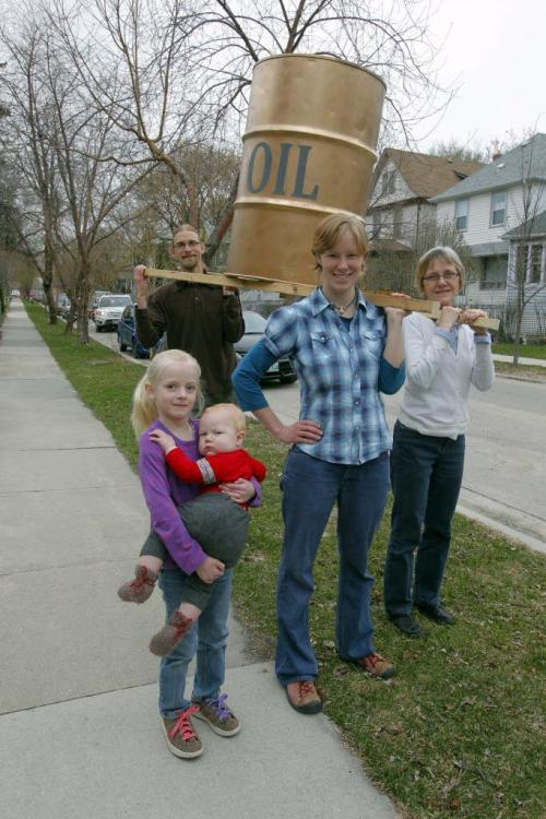 Christians invited to a Consumption Sabbath for Earth Day, where they give up fossil fuels for a day. The day on April 22 includes a walk down Portage Avenue, then an old-style tent revival service at Memorial Park. Mike Smith, rear left to right, Mona Neufeld, Esther Epp-Tiessen. Kids Laurel smith holding baby Elias Neufeld. They hold an oil drum they will parade down Portage Avenue. April 17, 2012  BORIS MINKEVICH / WINNIPEG FREE PRESS