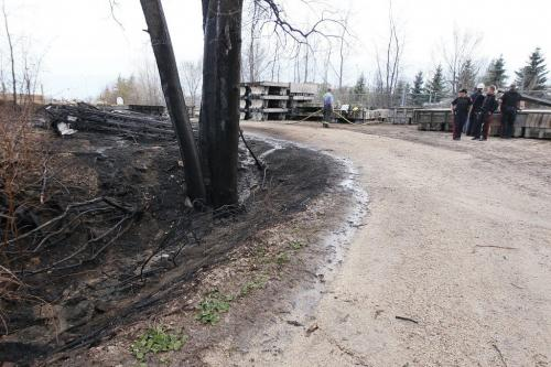 April 24, 2012 - 120424  - Fire investigators and police were on scene of a stored boat dock fire at The Forks Tuesday April 24, 2012.    John Woods / Winnipeg Free Press