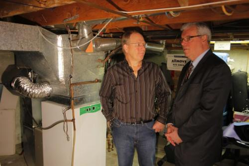 Home owner Bert Heinrichs talks to Manitoba Premier Greg Selinger in the basement of his home where he put in a high efficiency electric furnace. At press conference for new program for people who want to make their homes more efficient. May 8, 2012  BORIS MINKEVICH / WINNIPEG FREE PRESS