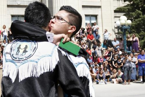 Brandon Courchene (right) kisses his brother Dallas after being inducted into Manitoba's Order of the Buffalo Hunt on Thursday. May 17, 2012. SARAH O. SWENSON / WINNIPEG FREE PRESS