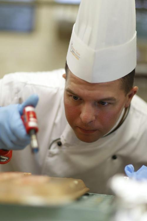 Chef Jeremy Bender, a member of Culinary Team Manitoba, prepares protein dishes at St. Charles Country Club, during a trial run for the Culinary Olympics, Saturday, May 26, 2012. The team is preparing for the event taking place in Germany in October. (TREVOR HAGAN/WINNIPEG FREE PRESS)